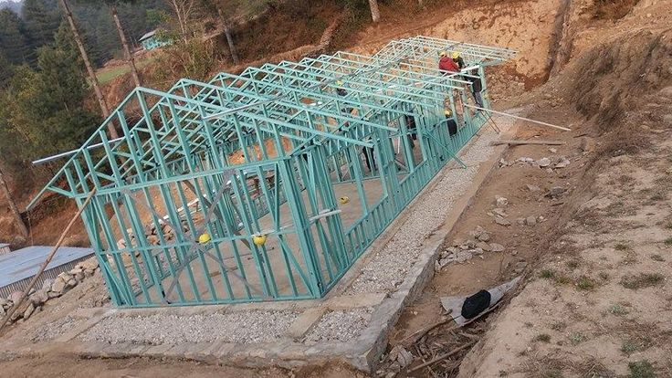 A steel construction is being used for some larger schools.  The steel frame means larger classroom sizes to accommodate more students.