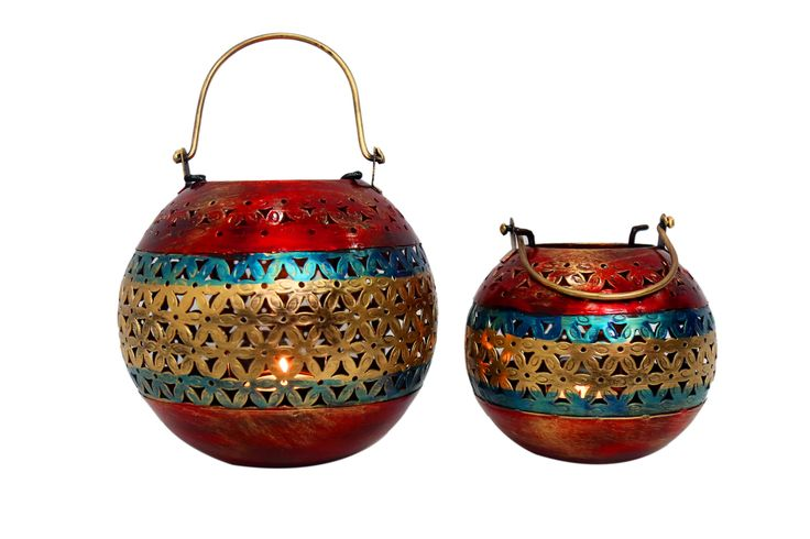 """This uniquely designed tea light holder in jali is designed for dim lighting.The light from the tea light diffuses beautifullyfrom the decorative cut work. This beautiful piece comes in a pair and will definitely catch the eyes of your guests because of its vibrant appeal and shimmering light effect.(There may be very MINOR VARIATIONS in color combinations and figure designs ) That is an Indikala promise)."""