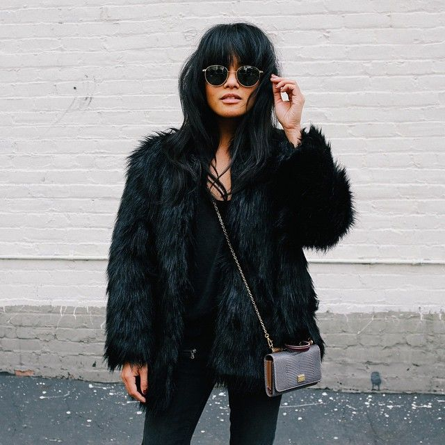 style lessons from blogger @lustforlife in a shaggy faux fur coat and round sunglasses