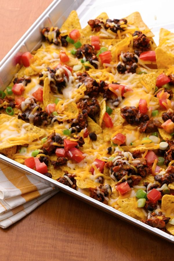 Grilled nachos - just layer taco flavors in a foil pan, cover and dig into the melty goodness in minutes!