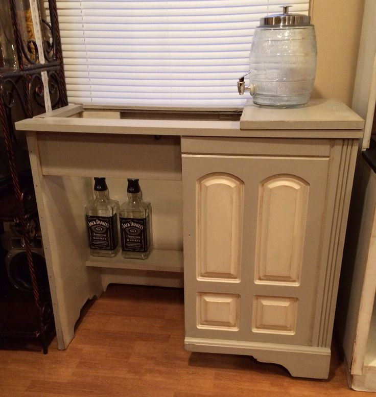 After- chalk painted vintage seeing machine cabinet turned into a bar - opening for the cooler