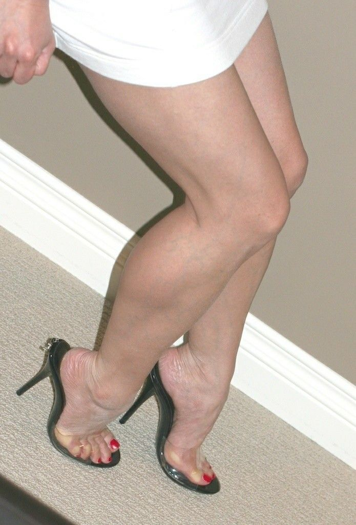 Clear mules and great legs