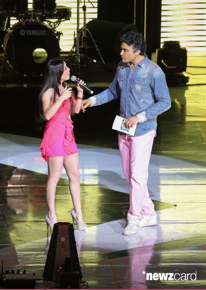 Violeta Isfel  and host Jaime Camil speak onstage at the Kids Choice Awards Mexico 2012 at Pepsi Center WTC on September 1, 2012 in Mexico City, Mexico.  (Photo by Victor Chavez/WireImage)