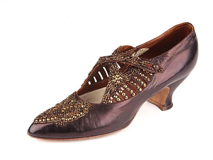 Aubergine colored leather shoes, decorated with metal beading and figural criss-cross straps. USA. Circa 1912-1915.