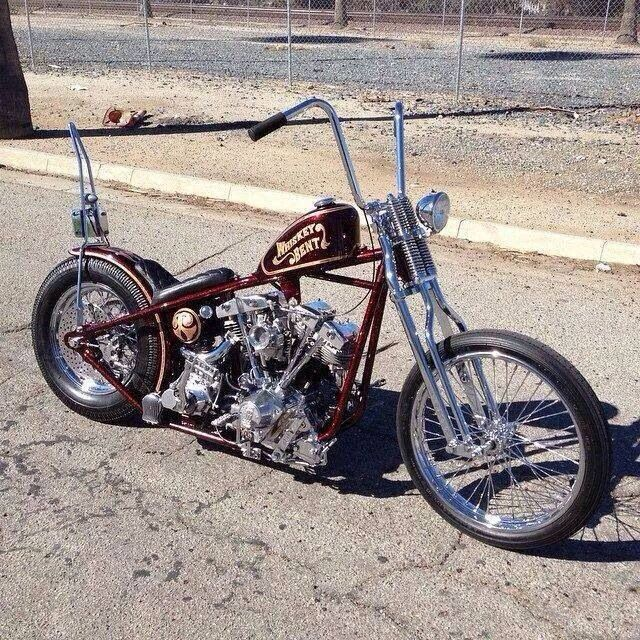 Shovelhead hardtail custom with split rocker boxes, root beer brown paint job, skinny springer front end with spool hub