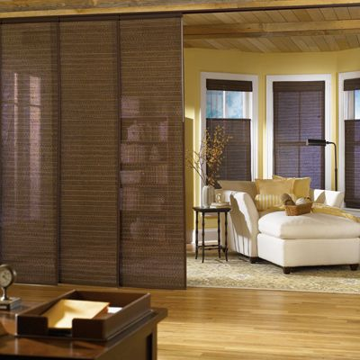 Panel Track Blinds Design Guide: Panel Track Blinds, also referred to as sliding panels, offer a new and innovative idea for covering extra large windows and sliding glass doors. Hanging panels span your window or stack neatly over each other when opened. These sliding panels also work great as a room divider.