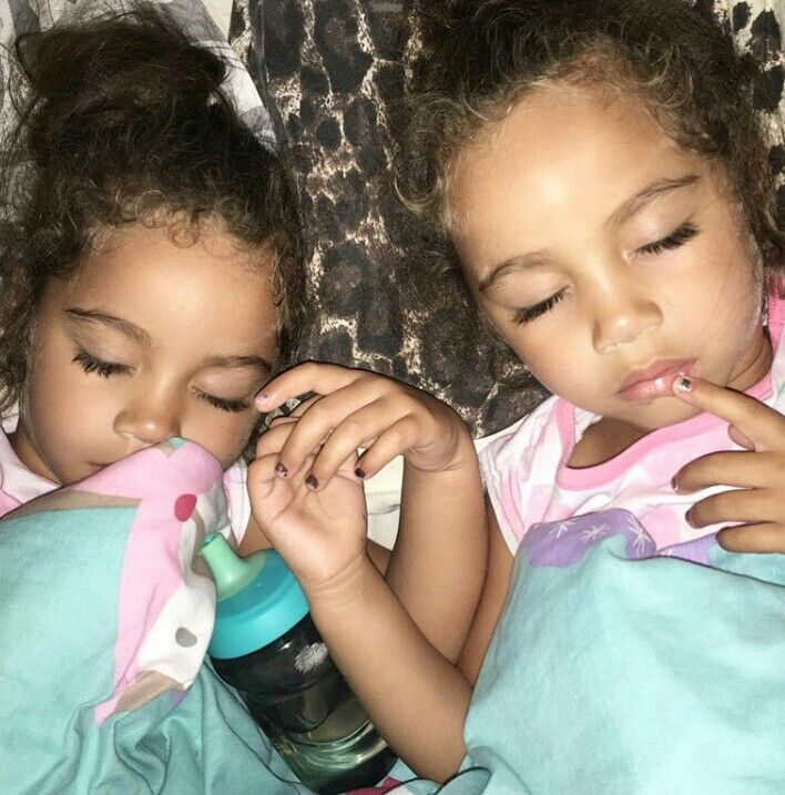 Cute black twin baby girls