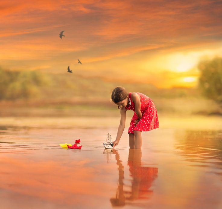 """Sail away... - Little girl playing with boats on a lake at sunset....   <a href=""""https://www.facebook.com/pages/Broquart-Photography/374405426079137?ref=aymt_homepage_panel/"""" target=""""_balnk""""> 