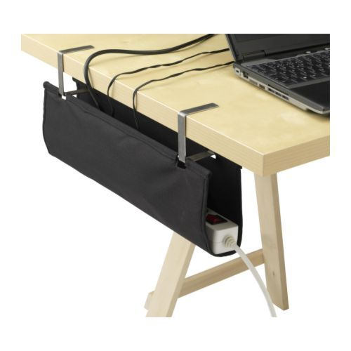 SIGNUM Cable organiser IKEA Attaches to a table top or TV bench for hidden, but easily accessible storage of cables and power strips.