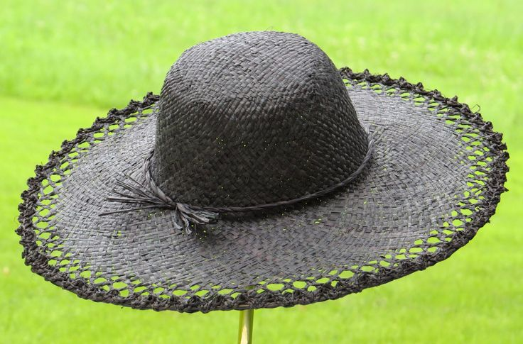 Skilfully handcrafted Fair Trade hat with spring green field in the background.