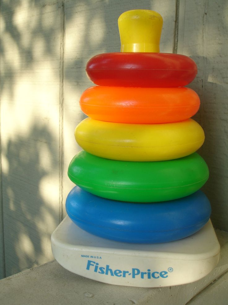 "FISHER PRICE TOY RING STACKER ""The song I made up for Eric: Red, orange, yellow, Green and blue; These little stacking rings are just for you."""