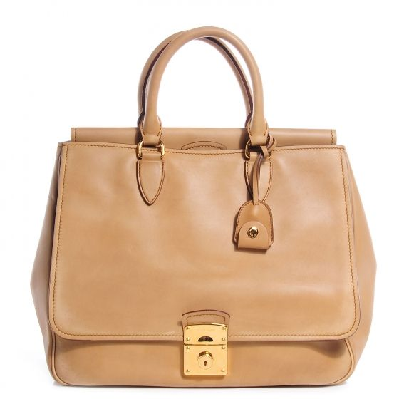 This is an authentic MIU MIU Vitello Satchel in Sabbia.   This fine tote is crafted of exceptional calfskin leather.