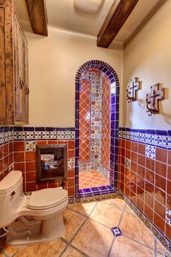¡Me Gusta!  The expansive use of tile is really eye catching. The only thing I'm not crazy about is the stark white toilet. I'd go with a buff color instead.