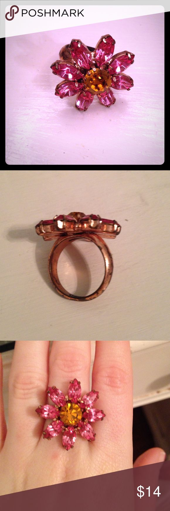 Coach flower ring Coach ring, pink flower orange center. Band is very worn, size 6, I believe. I have small fingers and it fits my middle finger. Coach Jewelry Rings