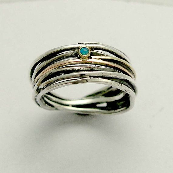 Sterling silver wrapped band mixed gold with blue opal.