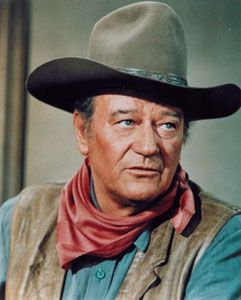 "John Wayne was a very famous 1950's actor. He always played the good guy in cowboy movies.born may 26th, 1907 in Winterset, Iowa. John Wayne was a well renowned movie star. He was in almost 250 movies and played a role in a radio series called, ""The Three Sheet to the Wind."" John Wayne died at the age of 72 from health complication on June 11th, 1979."