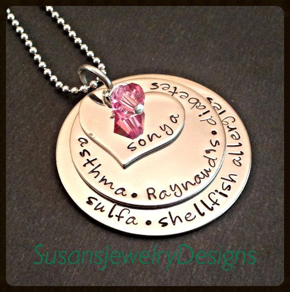 This necklace is made with stainless steel round and heart shaped discs that have been hand stamped by myself with your choice of wording