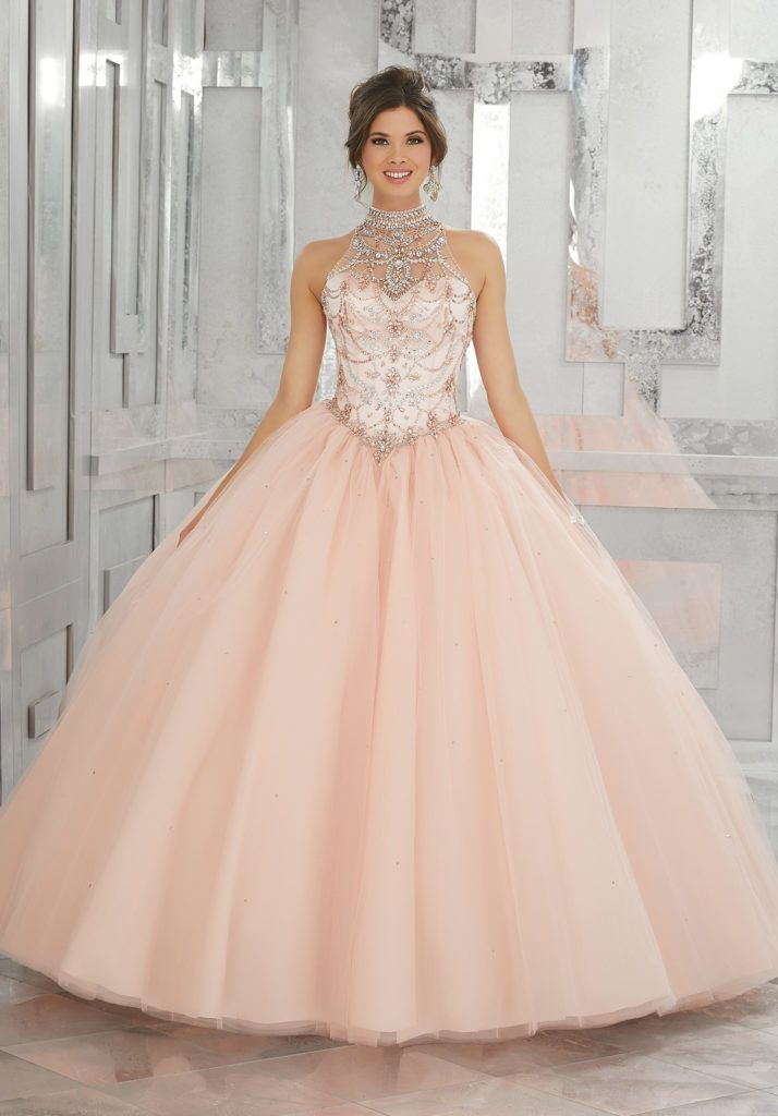 Quinceanera Dresses by Morilee designed by Madeline Gardner. Beautiful Ballgown featuring a Fully Beaded Bodice with High Neckline and a Keyhole Corset Back.