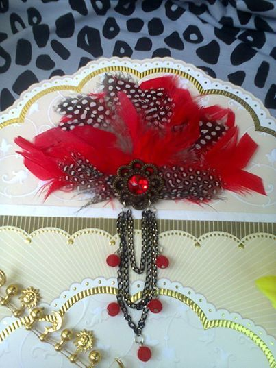 Polka in red feather brooch/clips