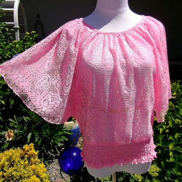 Lace Batwing pink top cover up In great pre-owned condition! Sheer lace Batwing top. Would look great spaghetti top Cami under it! Or work nice as a cover up, with bikini top and shorts. Pictured on a small dress form. It's a youth xL but, fits me like a junior small... A little like free size.  Coming from a smoke free home ~   Reasonable offers are welcome ~   Bundle and save 15% & on shipping ~ knitworks Tops Camisoles