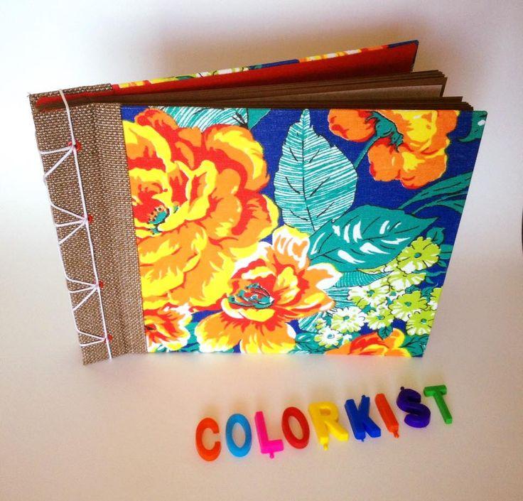 Álbum de fotos de Chita com costura japonesa e acabamento em ilhós. Capa e lombada em tecido. Miolo em papel color plus Marrom Havana, 180g e papel manteiga. 23 folhas.Guarda em tecido.