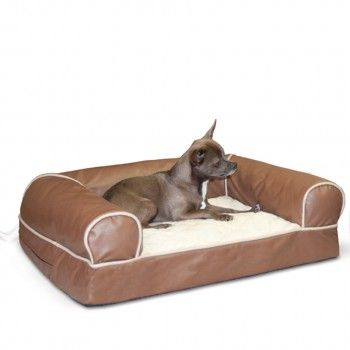 a luxurious heated dog bed with a plush quilted sleeping surface and generously filled bolsters - Heated Dog Bed