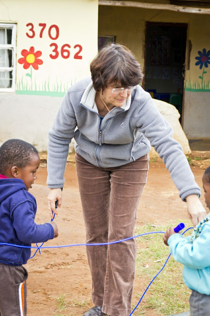 Volunteer Debbie gives an example of the different ways children can play with a jumprope at a weekly mentoring visit to Siyazama. To learn more about the Asidlale programme, visit our blog!