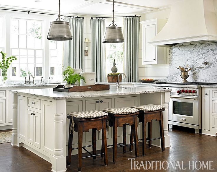 """Heavily veined marble was used for countertops, on the large island, & backsplashes. """"A lot of people complain about marble staining, but I like the way that ages it, the house doesn't scream 'new.' Everything needs history.""""  """"The kitchen is my favorite room. People can sit at the counter & no one feels crowded.""""  A whole-house sound system allows listeing to music while fixing meals & entertaining.   For easy cleanups, barstools are covered with indoor-outdoor """"Bikini Stripe."""
