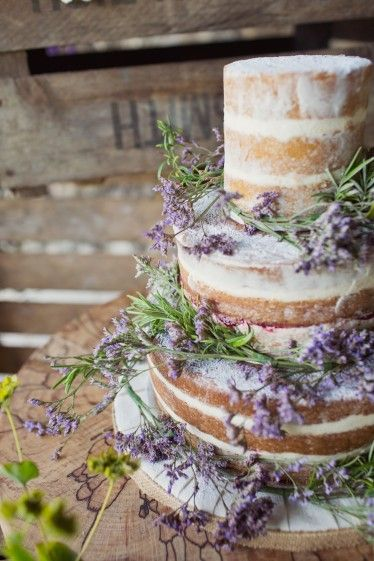 Lovely unadorned naked wedding cake with lavender