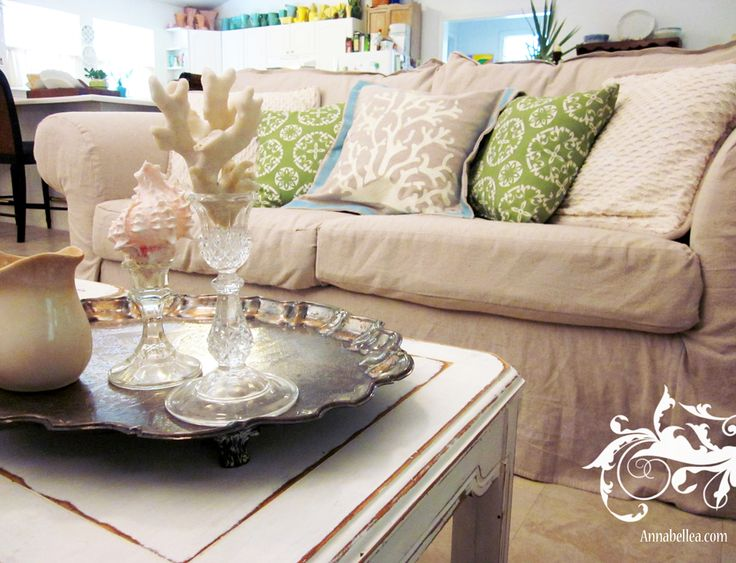 DROP CLOTHS (yes, like painters use for like $20!) to make furniture slip covers! What a great idea for a family (and pet) friendly way to keep furniture looking new!