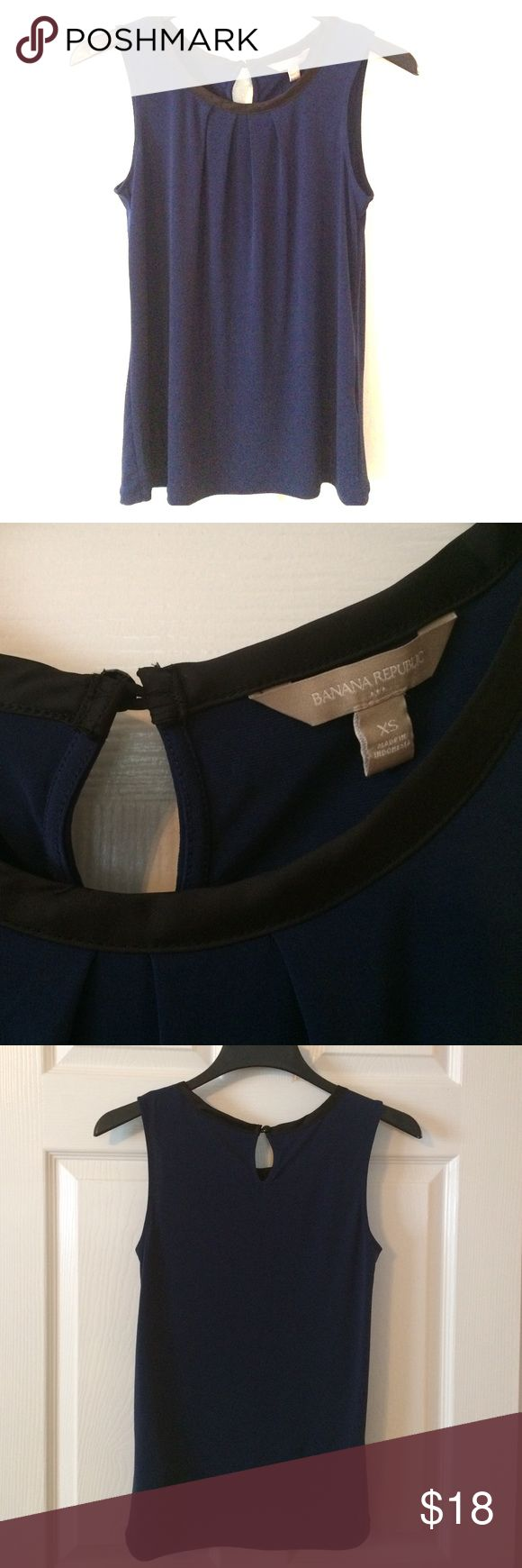 Banana Republic Sleeveless Blouse NWOT Deep blue sleeveless top with black satin trim.  95% polyester 5% spandex.  Machine wash.  NWOT.  The photo doesn't do the shirt credit - it's a beautiful, deep sapphire blue and the black satin trim really stands out. Banana Republic Tops Blouses