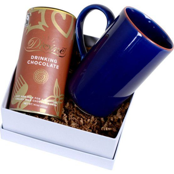 Chase away winter's chill with this hot drinking chocolate set meant to be savoured with a good book. Divine Chocolate is co-owned by the 85,000 farmer members of Kuapa Kokoo, a cooperative in Ghana and each mug is handcrafted in a family workshop in Bat Trang, Vietnam. A perfect fair trade combo.