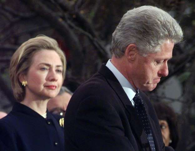 """** FILE ** First lady Hillary Rodham Clinton watches President Clinton pause as he thanks those Democratic members of the House of Representatives who voted against impeachment in this Dec. 19, 1998 file photo. Her husband's dalliances with Monica Lewinsky left Americans baffled, and at the same time admiring, that Hillary would stand by her husband. """"The most difficult decisions I have made in my life were to stay married to Bill, and to run for the Senate from New York,"""" she said. She…"""