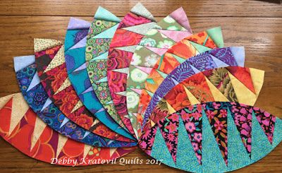 Paper pieced Rattlesnake units using a 1996 Karen Stone pattern and Kaffe Fassett fabrics.