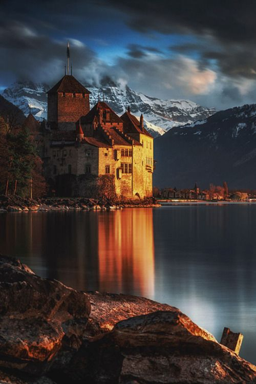 Chillon Castle sits on a rocky islet along the shores of Lake Geneva, Switzerland