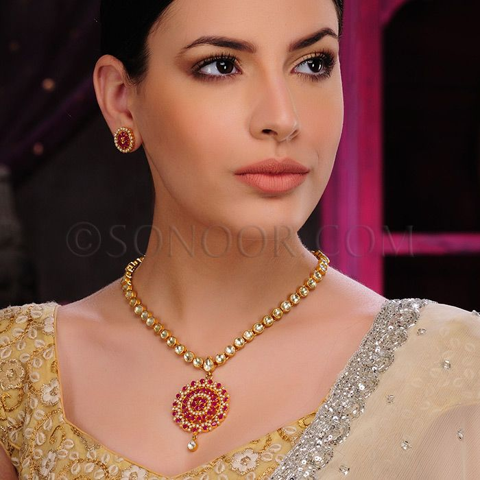 PEN/1/3436	 Manak Pendant Set with Earrings dull gold finish studded with kundan, pearls, and red jade stones 	$198	£117