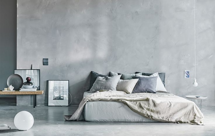 A natural colored airy bedroom space...,concrete love.