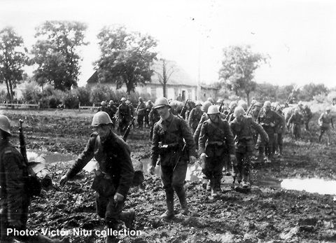 Romanian infantry marching in a mud road