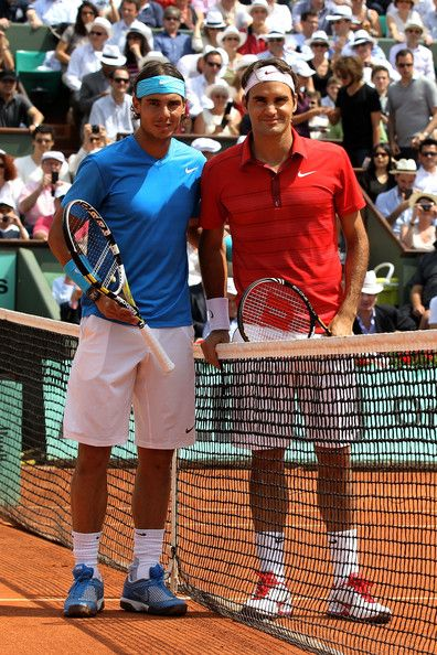 (L to R) Finalists Rafael Nadal of Spain and Roger Federer of Switzerland pose for the cameras prior to the men's singles final match between Rafael Nadal of Spain and Roger Federer of Switzerland on day fifteen of the French Open at Roland Garros on June 5, 2011 in Paris, France. (June 4, 2011 - Source: Matthew Stockman/Getty Images Europe)