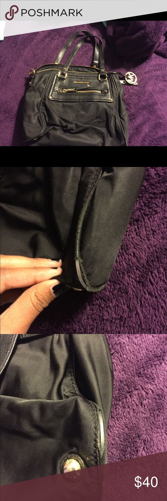 Black MK Purse Preloved Black MK Purse. Excellent condition. Flaws are showed in pictures. Besides that nothing else wrong with the purse. Feel free to ask any questions :) reasonable offers are welcomed Michael Kors Bags