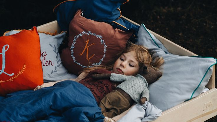 Kids bedding collection by NUKI. Embroidered bedding sets and cushion with customised typography.
