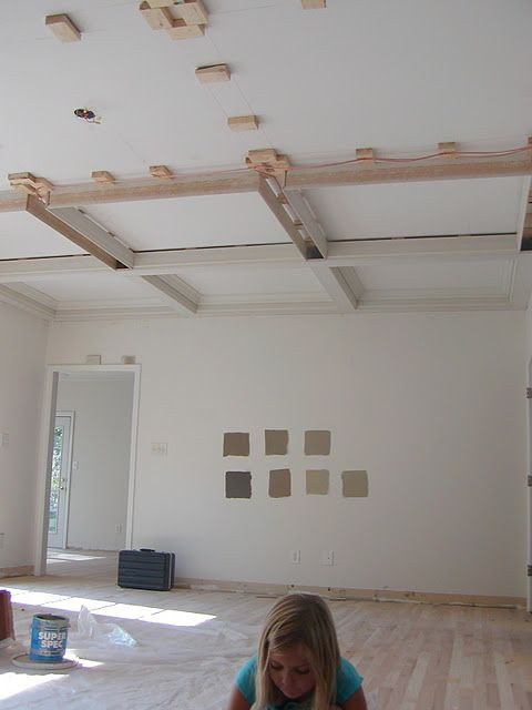 Idea for how to install faux ceiling beams. Most DIY plans show nailing an entire board to the ceiling. I like the idea of the smaller pieces being used... seems like a cost saver. Hmm?