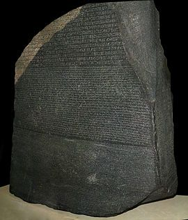 The Rosetta Stone, is a decree inscribed on behalf of King Ptolemy V. in 197-196 BCE. It is written in three different scripts, from top to bottom, Ancient Egyptian  hierogliphic, demotic, and ancient greek. The three inscriptions provided the key to the secrets of ancient Egypt.