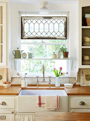Things I love about this kitchen: farmhouse sink, glass cabinet doors, old window panel at the top and the shelf across the window, the old tin tile back splash, need I go on??