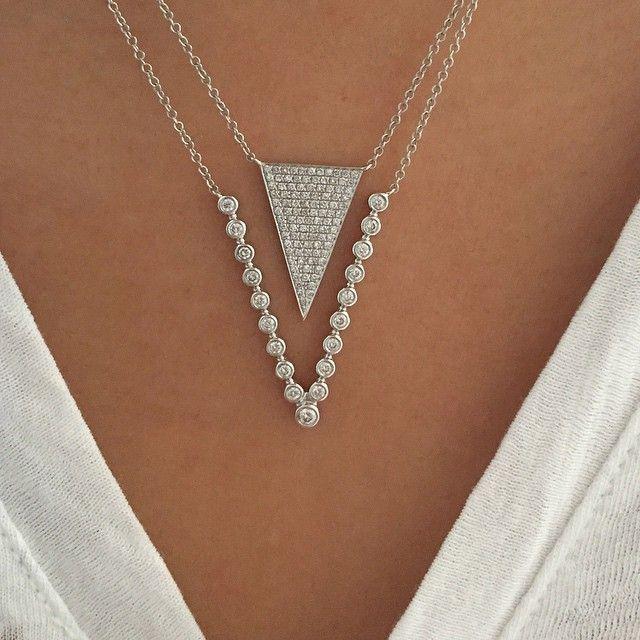White on white EFC layers today...Love my jumbo diamond triangle necklace layered with my new multi diamond bezel V necklace! ♡♡♡ Xo, EF