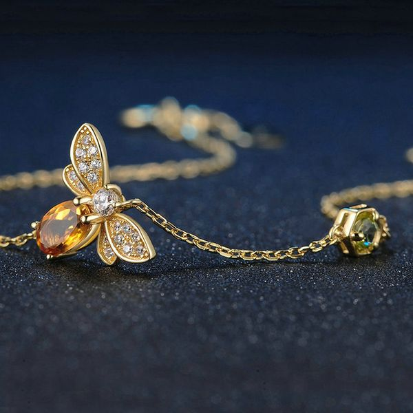 This is a dazzling pendant that gorgeously represents a November BornBee Lady. TheCitrine cutgem in the center is simply elegantand with the bee-themed desi