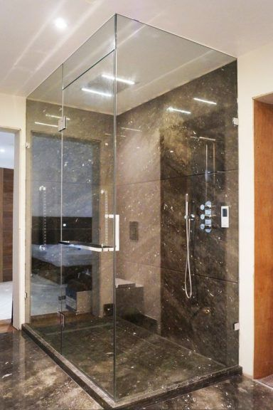 Clear glass frameless shower enclosure from Creative Glass Studio installed in London.