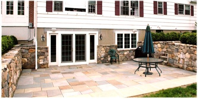 Walkout basement french doors to a lower level screened in for Walkout basement backyard ideas