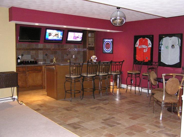 sports garage themed ideas - Basement sports bar with hardwired disco ball