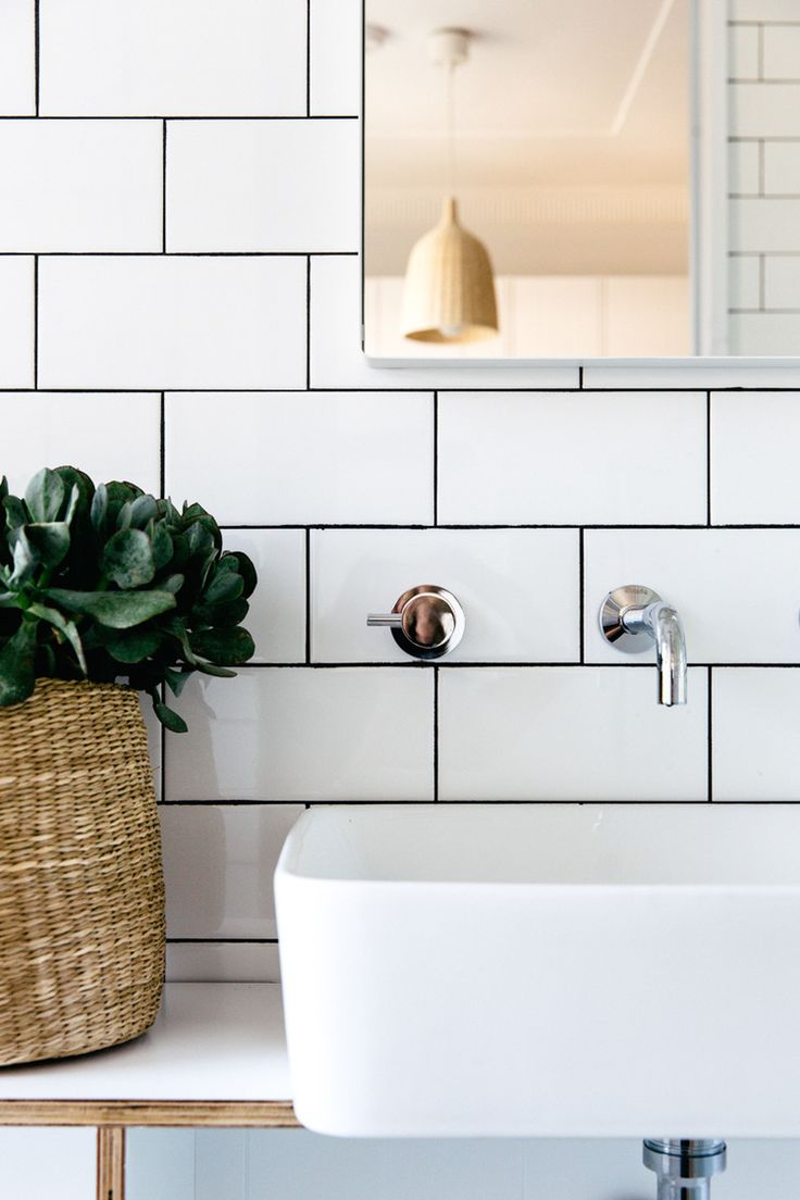 white subway tiles, dark grout + wood   styling work by c+m studio